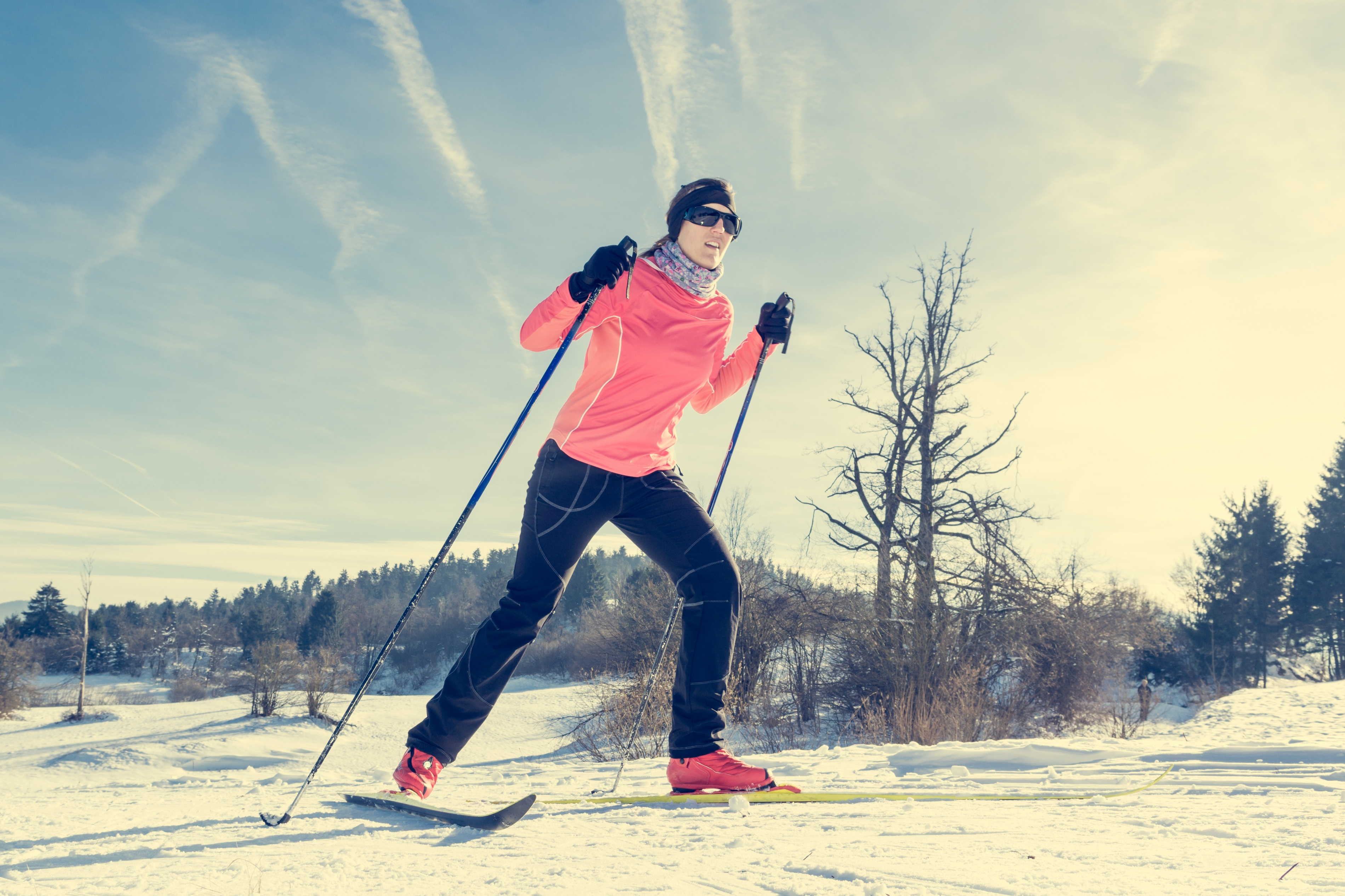 Woman cross country skiing on a yellow skis